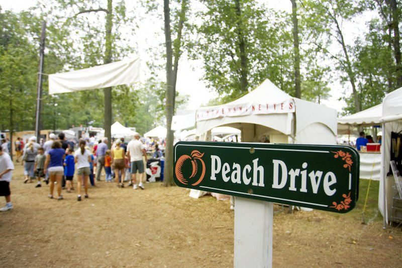 Peach festival crowd and sign