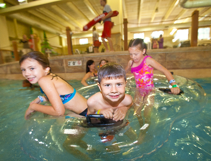 Kids in an inner tube | Great Wolf Lodge