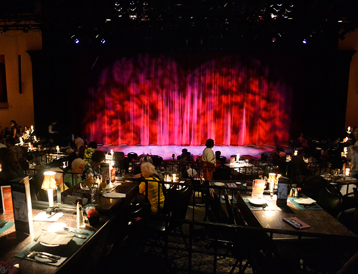 Interior of La Comedia | Stage and dinner tables