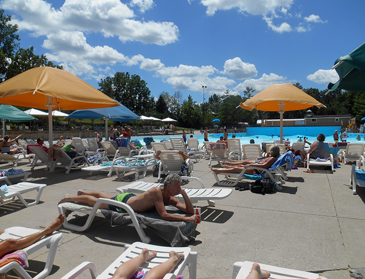 Tanning near the wave pool at The Beach Waterpark