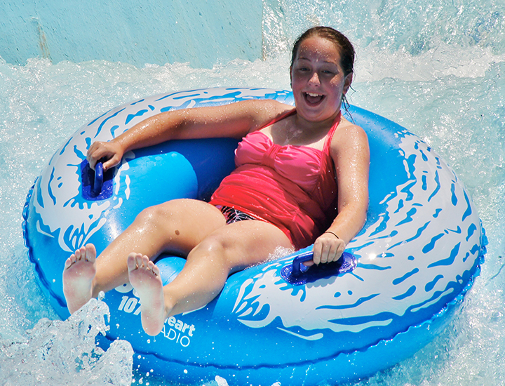The Beach | Riding in an inner tube down a water slide